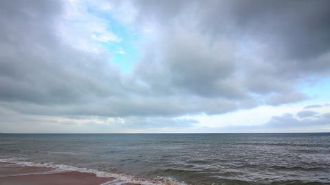 dramatic sea landscape with moody sky - timelapse Footage