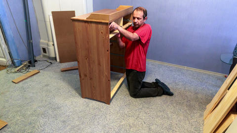 Man doing assembly furniture Footage
