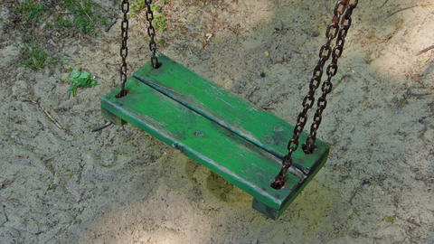 Old green empty swing Footage