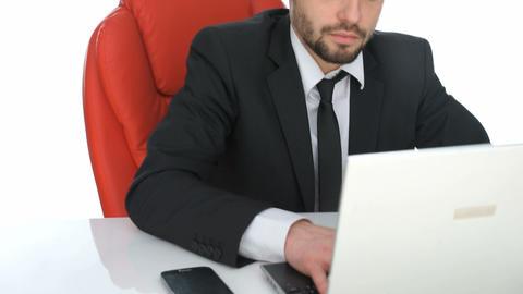 Hardworking businessman sitting at his desk Live Action