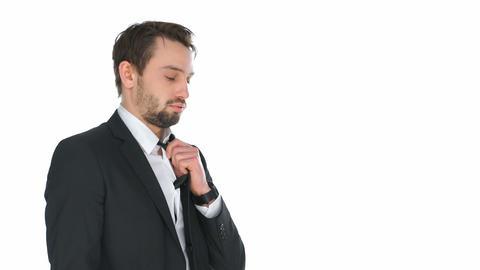 Stressed businessman adjusting his tie Live Action