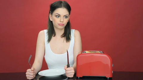 Hungry woman with an empty dinner plate Live Action