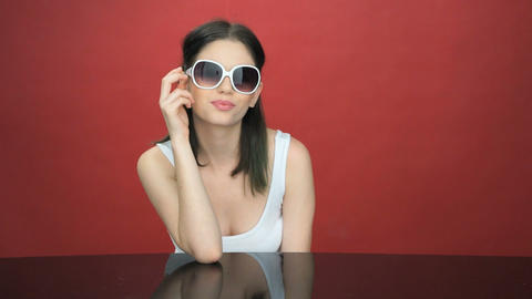 Sexy beautiful woman in trendy sunglasses Live Action