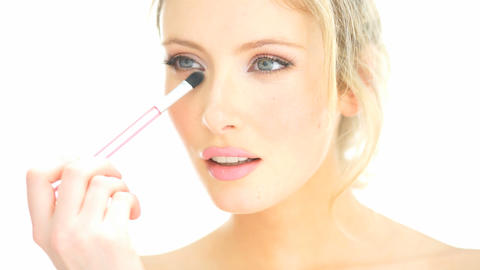 close-up blonde woman applying her lipstick makeup Live Action