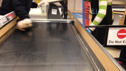 Cashier Cleaning The Checkout Food Belt stock footage