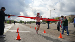 Marathon Winner Crosses Finish Line Slow Motion stock footage