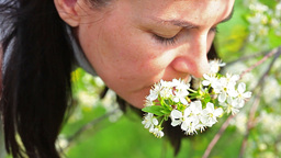 Beautiful Women Smelling White Flowers In Springti stock footage