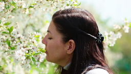 beautiful women smelling white flowers in springti Footage
