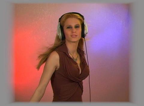Beautiful Blonde with Headphones Footage