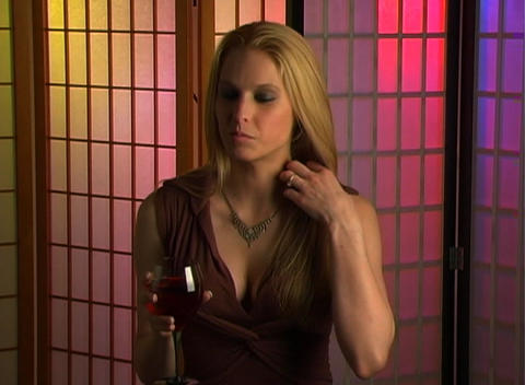 Beautiful Blonde with a Glass of Wine (2) Stock Video Footage