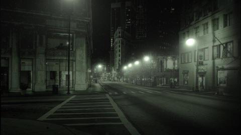 Snowy city street at night Stock Video Footage