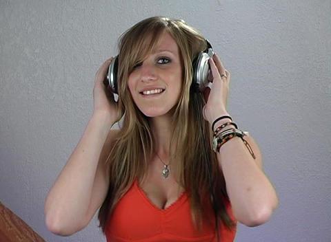 Beautiful Teenage Blonde with Headphones (3) Footage