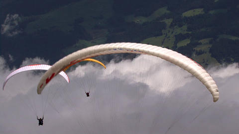 paraglider in a row Stock Video Footage