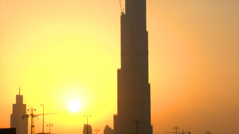 sun at Burj Dubai tilt Stock Video Footage