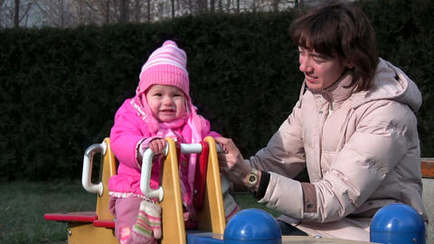 baby and mother at playground Footage