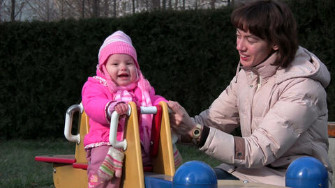baby and mother at playground Stock Video Footage