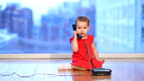 baby picking up the phone Stock Video Footage
