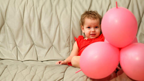 baby girl with balloons Stock Video Footage