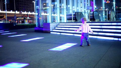 baby dancing over floor light Stock Video Footage