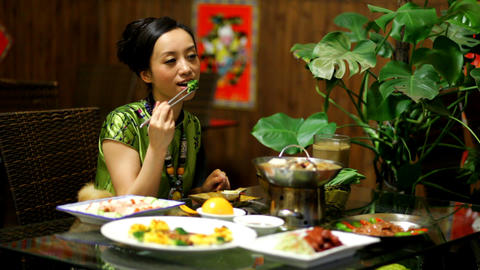 Asian woman eating Stock Video Footage
