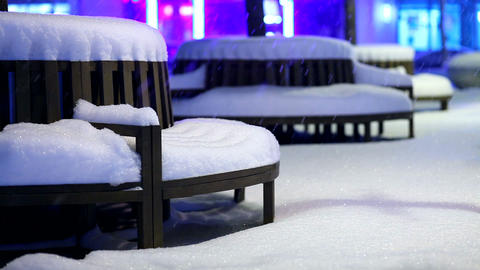 park bench covered by snow Stock Video Footage