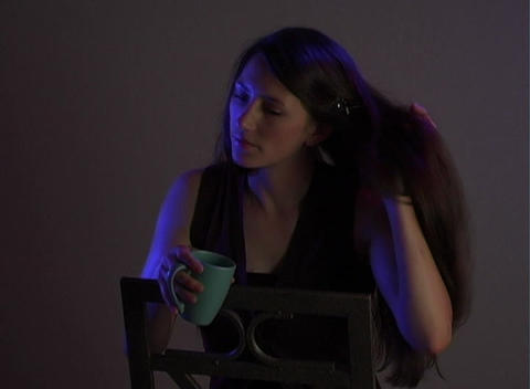 Beautiful Young Brunette Sitting Alone (4) Stock Video Footage