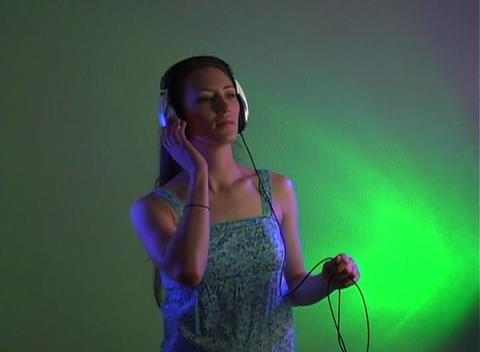 Beautiful Young Brunette with Headphones Footage