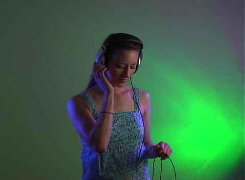 Beautiful Young Brunette with Headphones Stock Video Footage