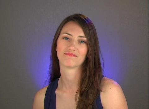 Beautiful Young Brunette with Sarcastic Sympathy Stock Video Footage