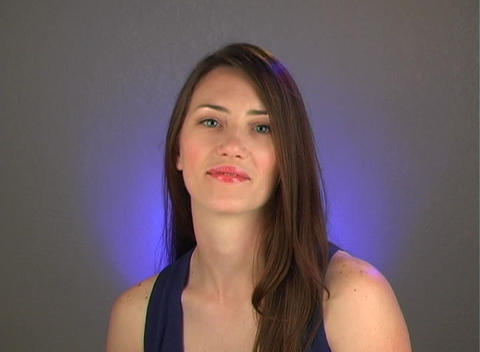 Beautiful Young Brunette Shrugs Her Shoulders Stock Video Footage
