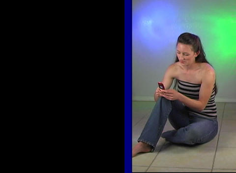 Beautiful Young Woman Texting on her Cell Phone Stock Video Footage
