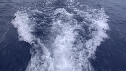 realtime water swirl behind a boat Stock Video Footage