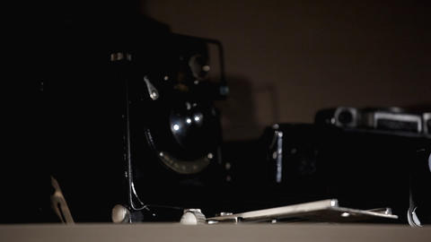 pan on row of old photo-cameras Stock Video Footage