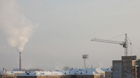 Tube with smoke and crane at winter morning Footage