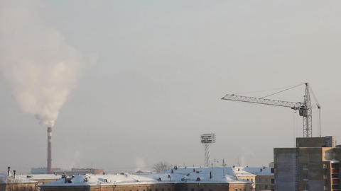 Tube with smoke and crane at winter morning Stock Video Footage