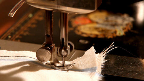 Pan on stitching machine - finish sewing Stock Video Footage