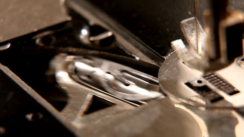 stitching machine detail macro - shuttle Stock Video Footage