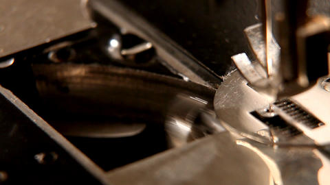 stitching machine detail macro - shuttle Stock Video Footage