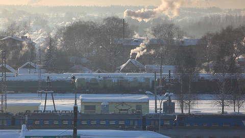 Train arrival at winter rail station Stock Video Footage