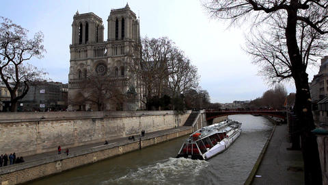 Notre Dame de Paris and pleasure boat on channel Stock Video Footage