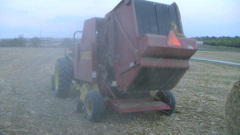 Round Baler at Dusk Stock Video Footage