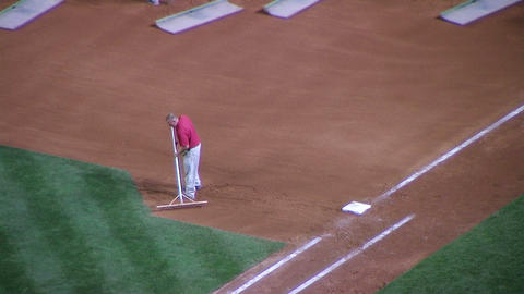 Man Raking Baseball Infield Stock Video Footage