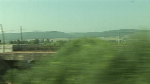 View Of Agriculture Landscape From A Moving Train  stock footage