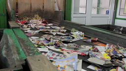 Wastepaper at conveyor line - recycling center 1 Live Action