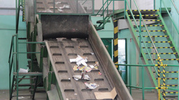 Wastepaper at recycling plant Live Action