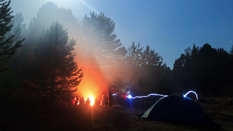 People around the campfire at night. Time Lapse Footage