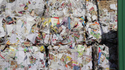 Stack of wastepaper at recycling plant Live Action