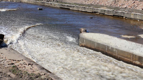protective dam dumps water on the river Footage