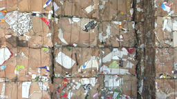 Stack Of Recycled Cardboard Sorted In Cubes stock footage