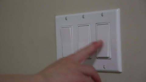 Close up clips of woman's had turning light off Footage